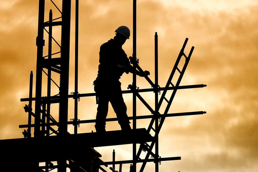 bigstock-silhouette-of-construction-wor-79484899